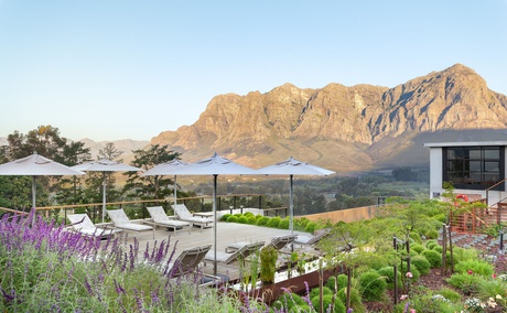 De Zeven Guest Lodge, mountain views and pool deck. Located in Banhoek Valley, near Stellenbosch and Franschhoek, Cape Winelands South Africa.